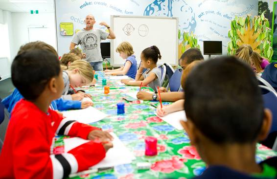 Andrew conducts a kids' cartooning workshop