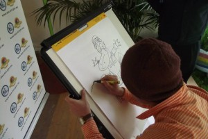 Andy drawing in the SES expo tent during Canberra's Floriade festival, 2013